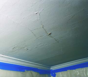 ... shadows—the telltale signs of a delaminating plaster ceiling