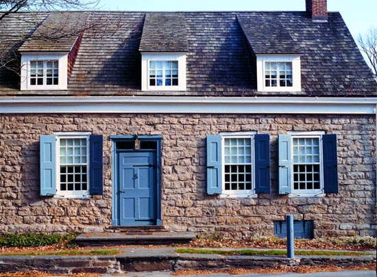 Dutch colonial stone house furnished with local antiques for Front doors for colonial homes
