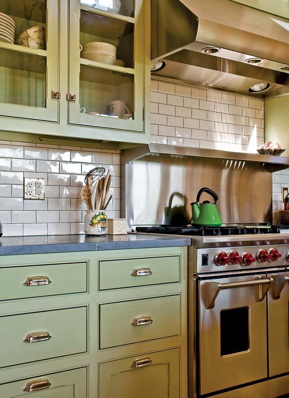 The kitchen backsplash is finished in white subway tiles for easy
