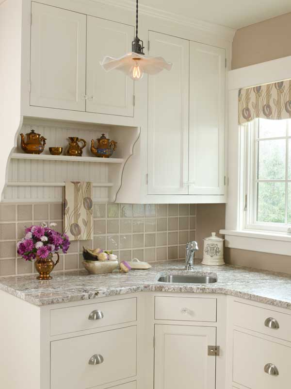Honed granite countertops, beige tile, and a Mackintosh print valance
