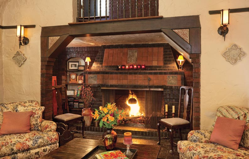 Mediterranean living room with high ceiling by jack for Tudor fireplaces