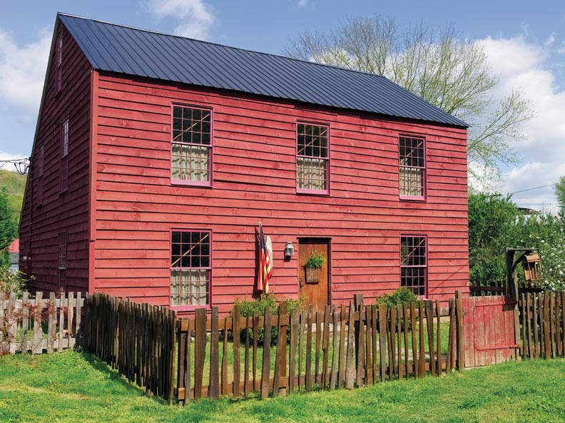 Folk art in a reproduction saltbox old house online for Reproduction farmhouse plans