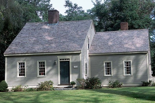 This palette of soothing greens on an 18th century cape cod style