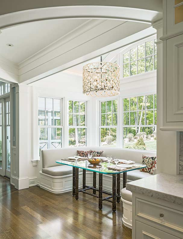 ... nook bay. Oversized windows surround the banquette, making the dining